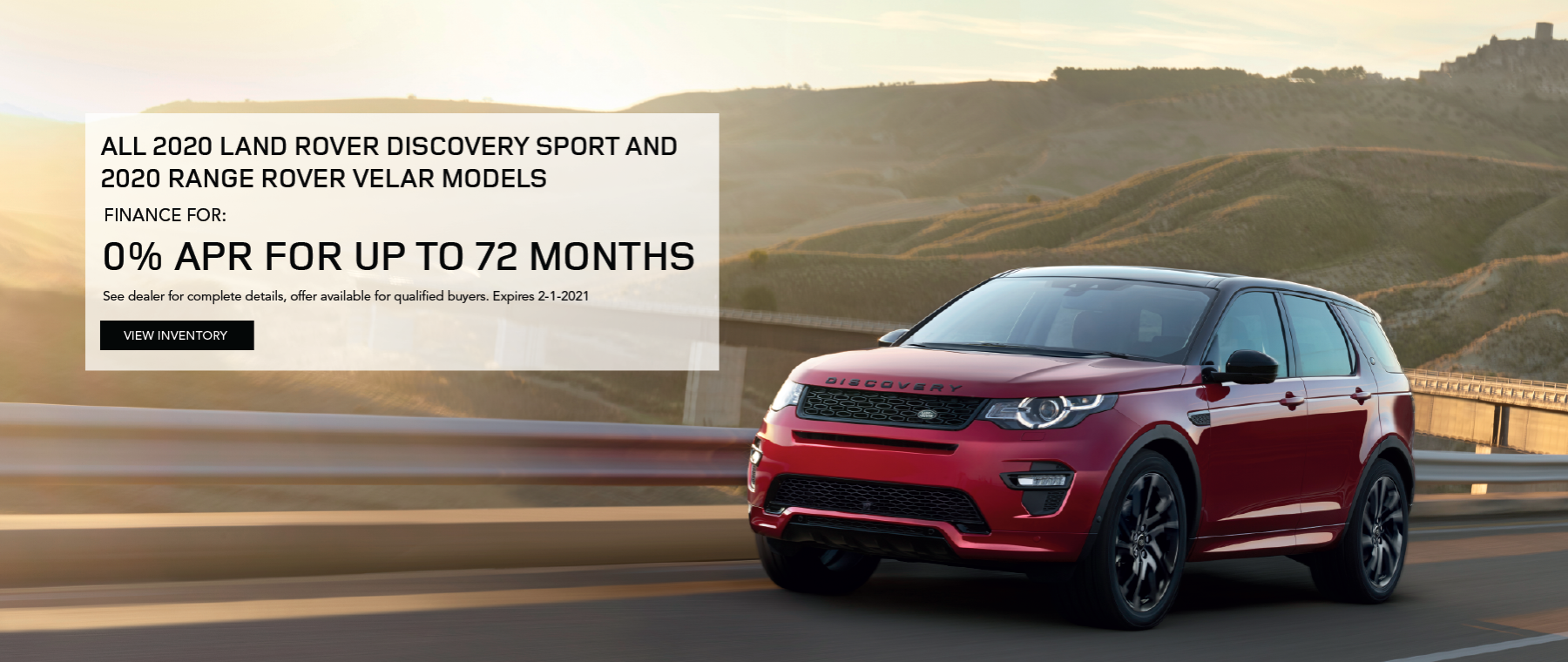 RED 2020 LAND ROVER DISCOVERY SPORT DRIVING ON ROAD WITH MOUNTIAN IN DISTANCE CLICK TO VIEW INVENTORY.