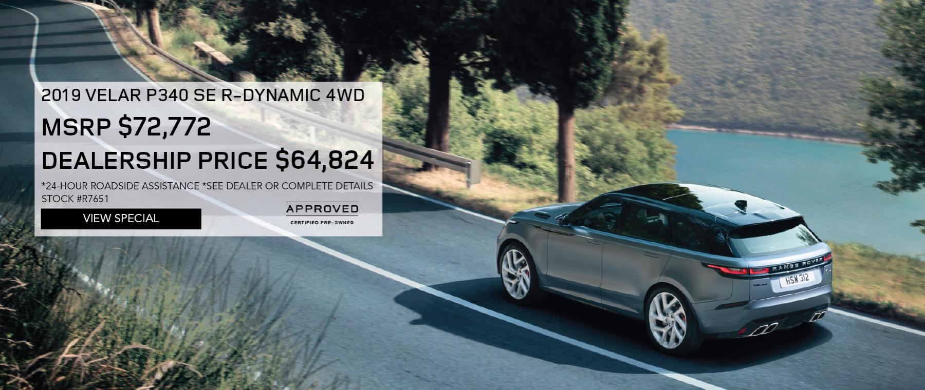 Stock #R7651 – Certified pre-owned Grey 2019 Velar P340 SE R-Dynamic 4WD on road near trees MSRP - $72,772 Dealership price - $64,824. *24-hour roadside assistance. See dealer for complete details.