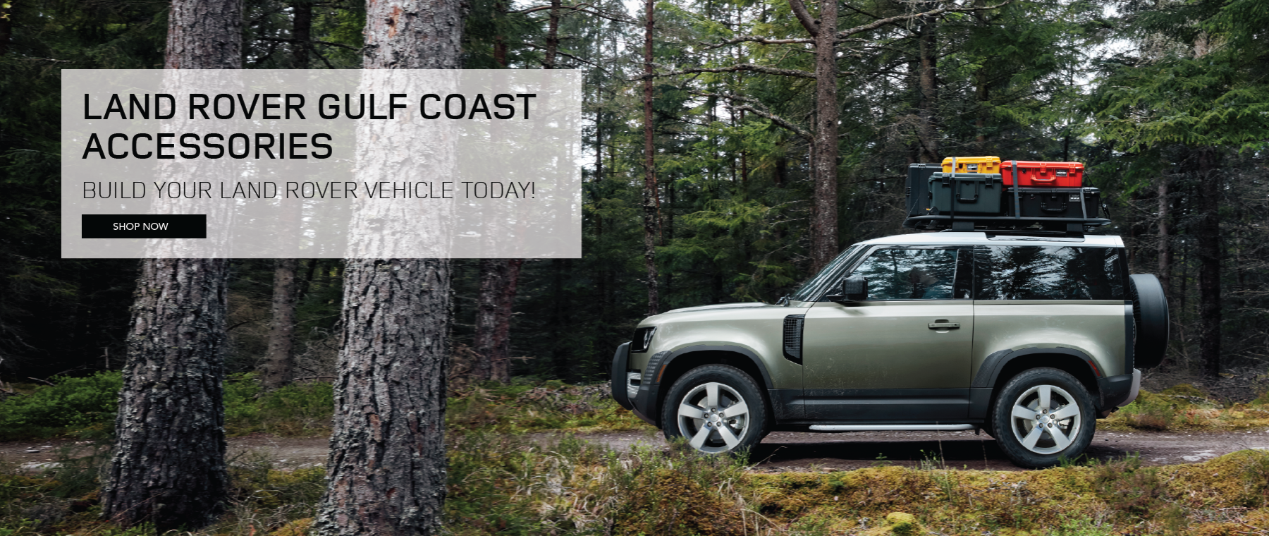2020 Land Rover Defender driving though wooded road. Click to shop accessories now!