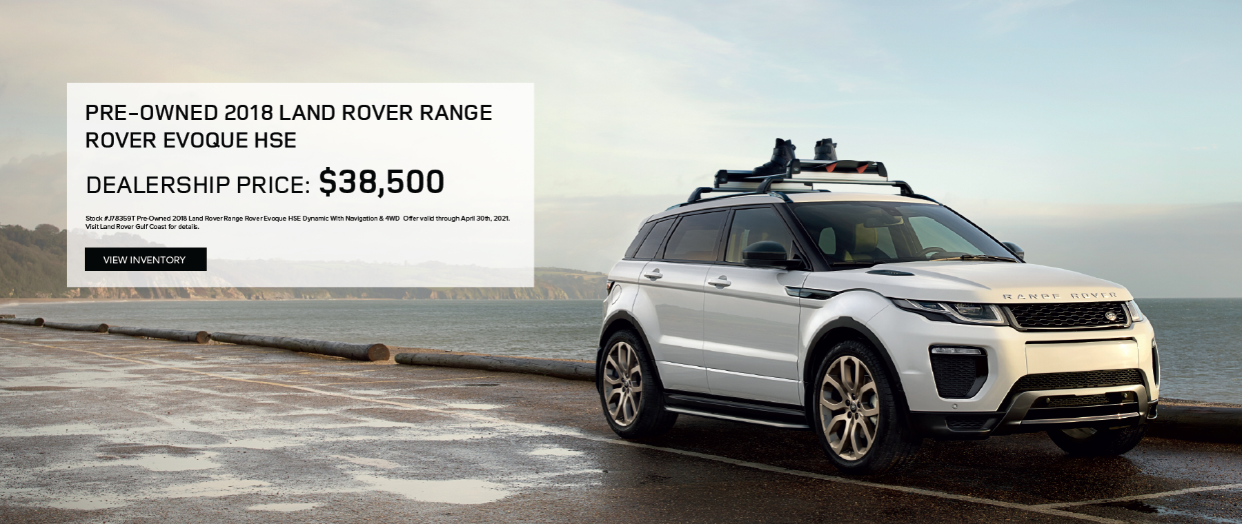 White PRE-OWNED 2018 LAND ROVER RANGE ROVER EVOQUE HSE DYNAMIC WITH NAVIGATION & 4WD on road near water.Click to view vehicle.