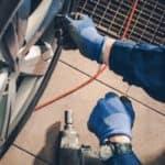service technician replacing tire