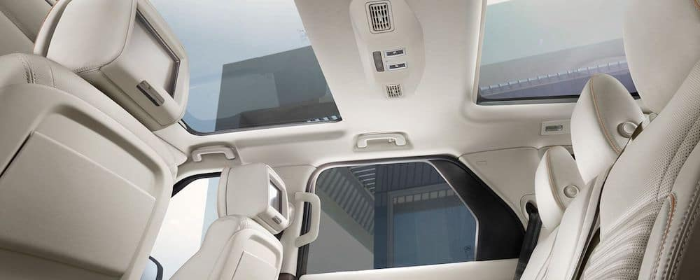 2019 land rover discovery interior with ivory perforated leather seats and view of panoramic roof