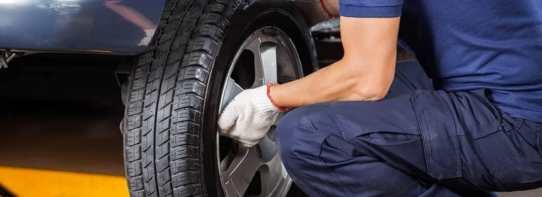 Person Changing Tire