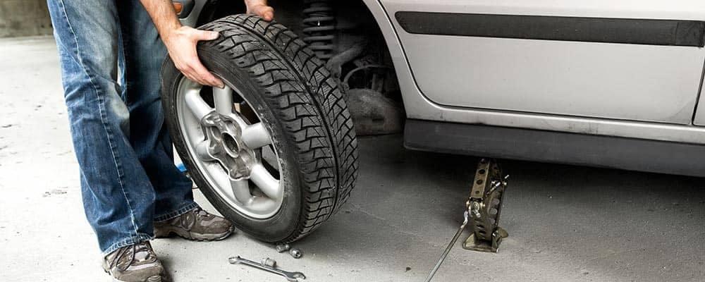 Man changing a flat tire