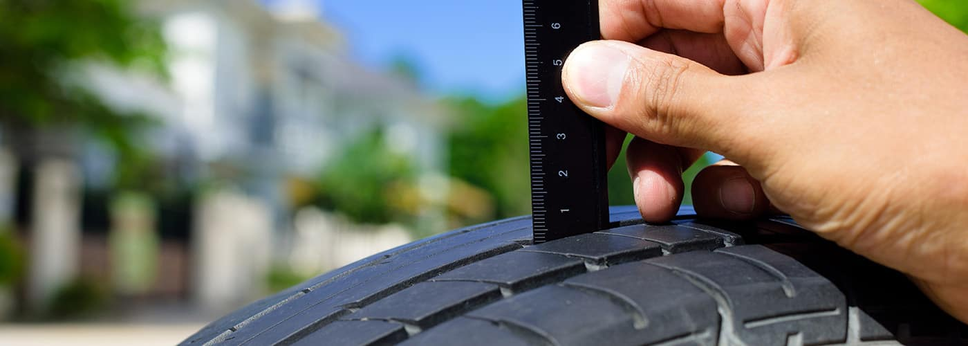 checking the depth of car tire tread