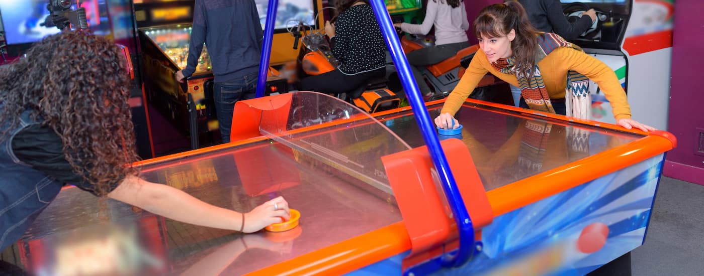 women playing air hockey