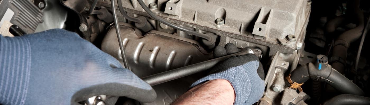 mechanic fixing auto parts