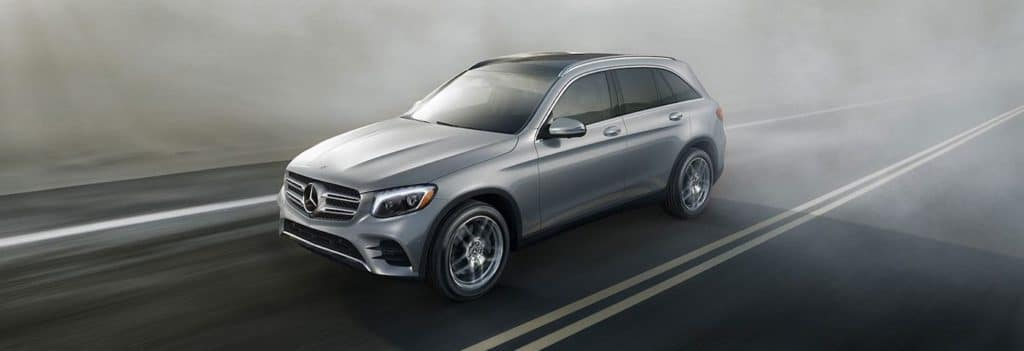 2019 mercedes-benz glc silver driving on road