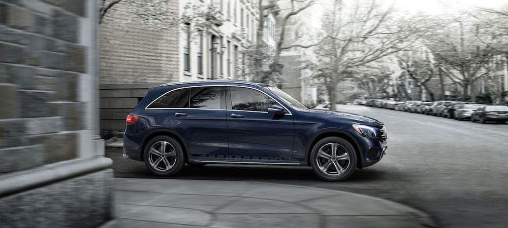 Blue Mercedes-Benz GLC driving in city