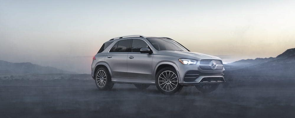 Gray GLE SUV in front of a foggy background