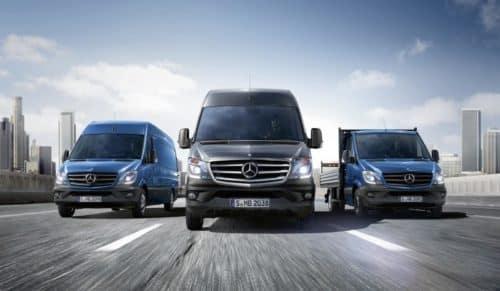 Three Mercedes-Benz Vans Driving Down Highway