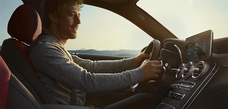 Man driving Mercedes-Benz GLC