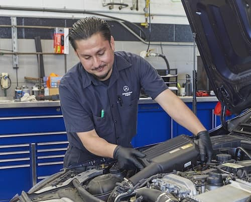Mercedes-Benz Tech Working on Vehicle