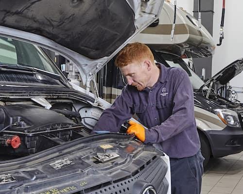 Mercedes-Benz Technician Working on Van