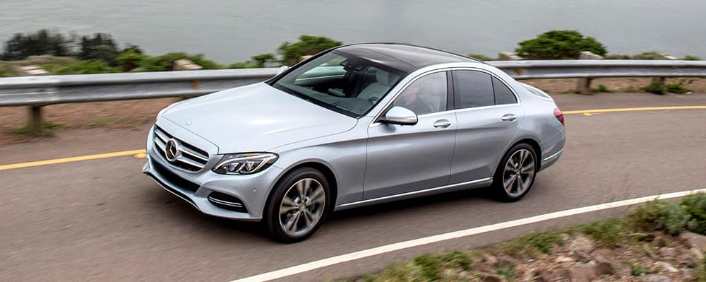 Silver C-Class Hybrid driving on a highway