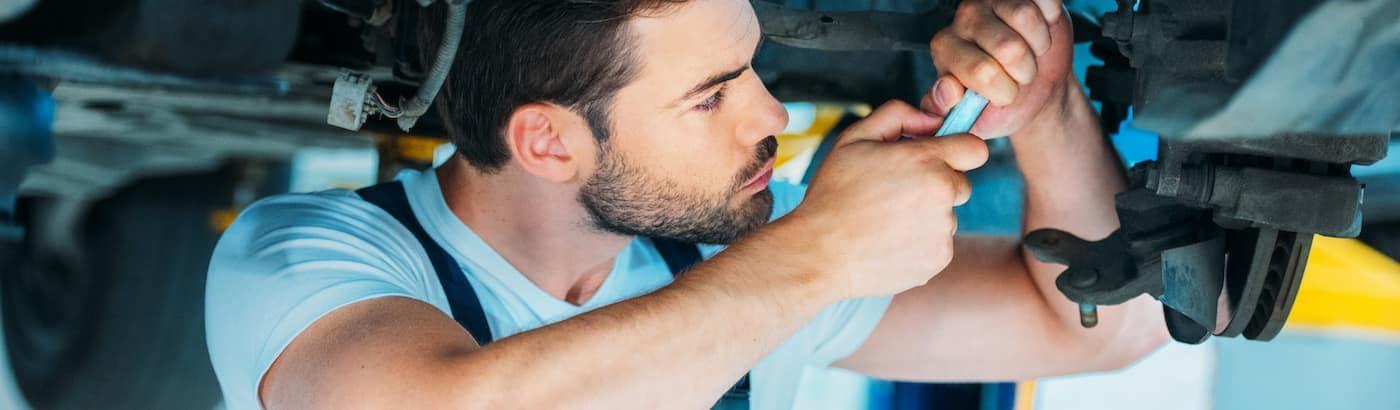 Man fixing car