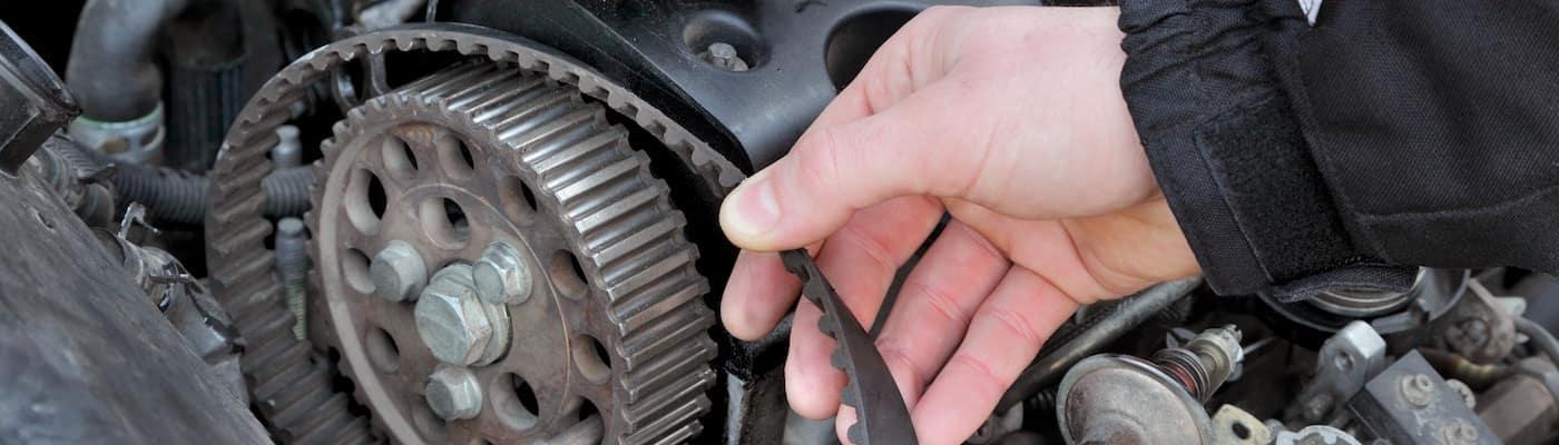 Man Fixing Timing Belt