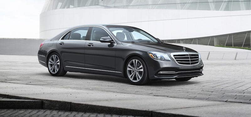 S-Class sedan parked on gray concrete