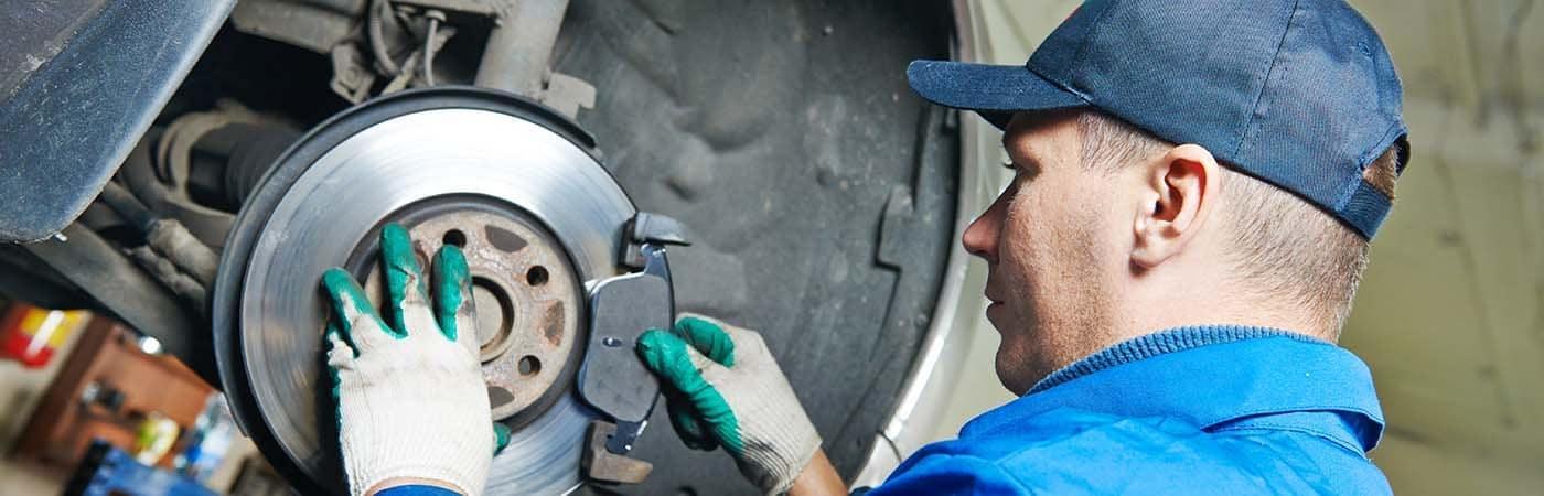 Man Changing Car Brakes