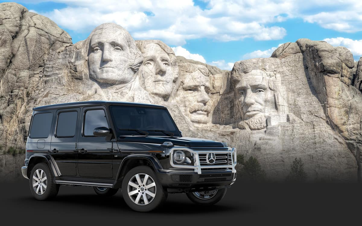 Mt Rushmore with a Merceders-Benz G-CLass SUV
