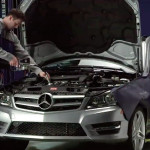 Mechanic Filling Oil in a Mercedes-Benz