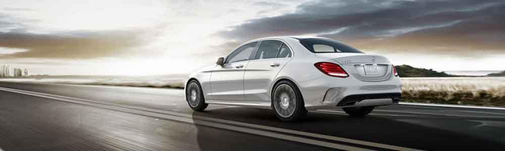 2018 Mercedes-Benz C-Class driving down the road towards the city