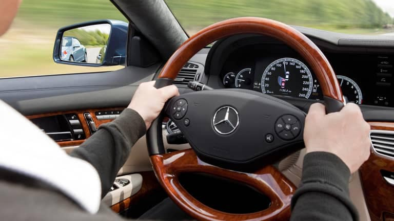Person driving a Mercedes-Benz Certified Pre-Owned Vehicle