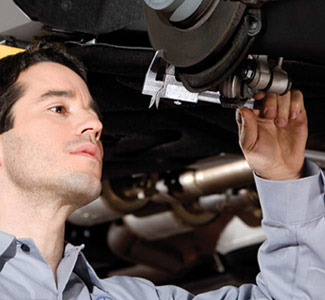 Service Technician working on vehicle