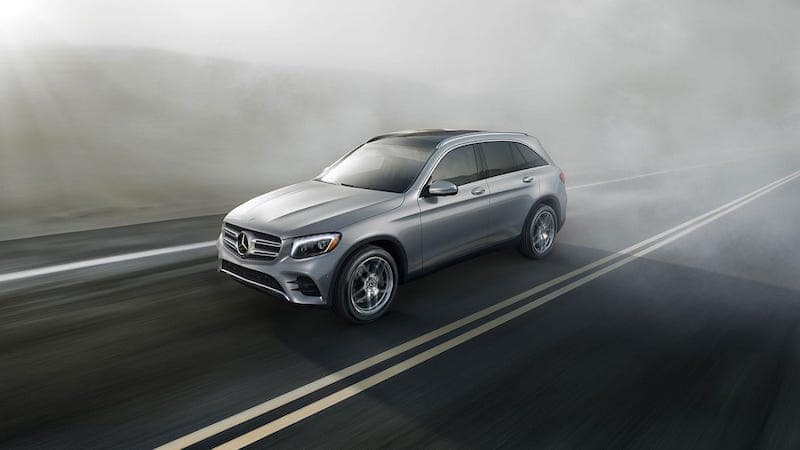 Gray GLC SUV driving in fog