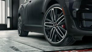 Close up of a black MINI Cooper S Clubman with 19 inch John Cooper Works Pro Radial Spoke 526 Summer Wheels.