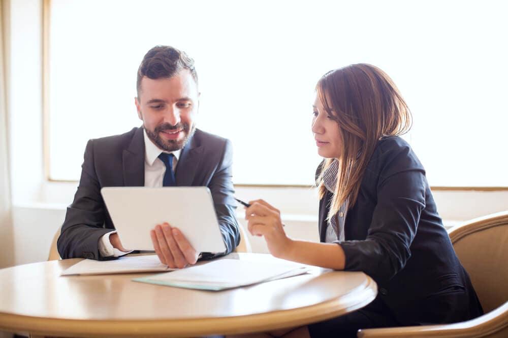 Two people having an interesting looking Finance Talk