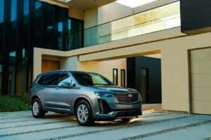 History of Cadillac vs Audi