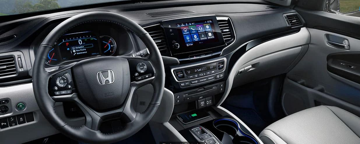 The interior of a 2020 Honda Pilot with the safety package
