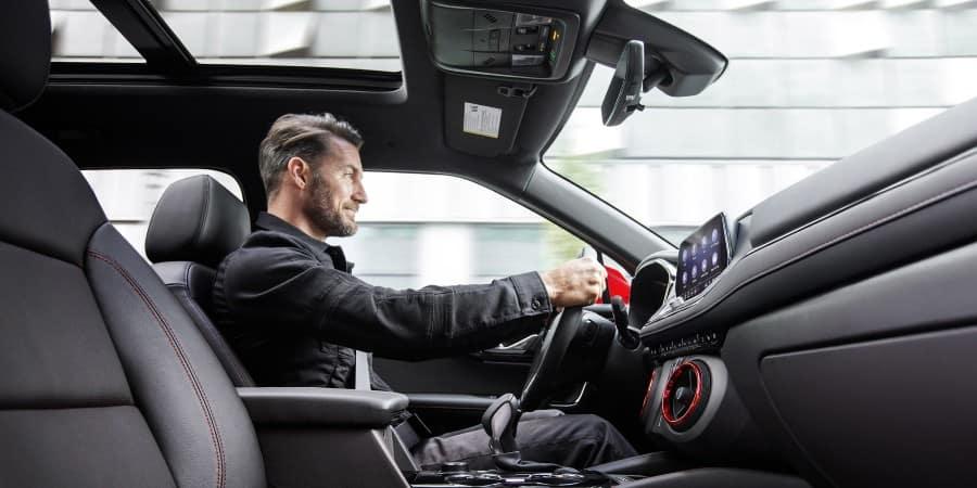 A man driving a 2019 Chevrolet Blazer RS - Sherman Chevrolet in Sherman, Texas