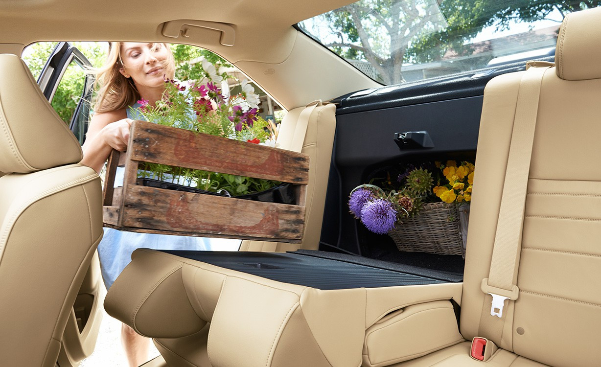 Woman putting flowers in a Toyota Camry