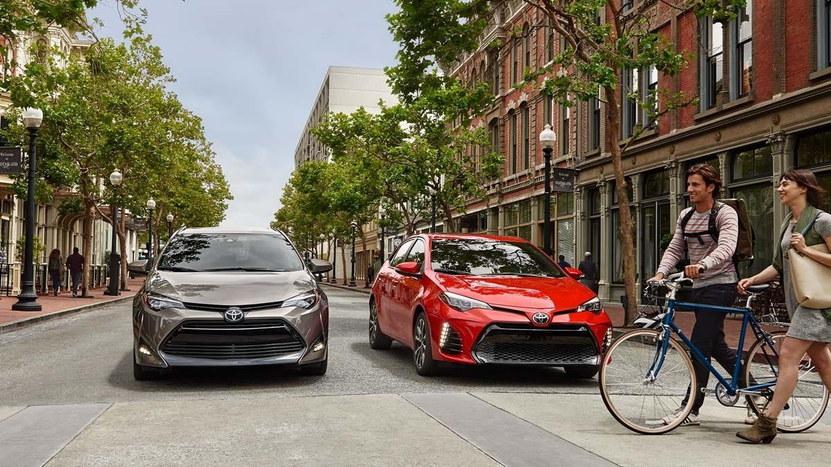 2017 Toyota Corolla Models stopped on city street