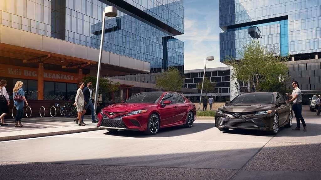 2018 Toyota Camry models parked outside a building