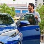 Man getting into 2018 Toyota Corolla