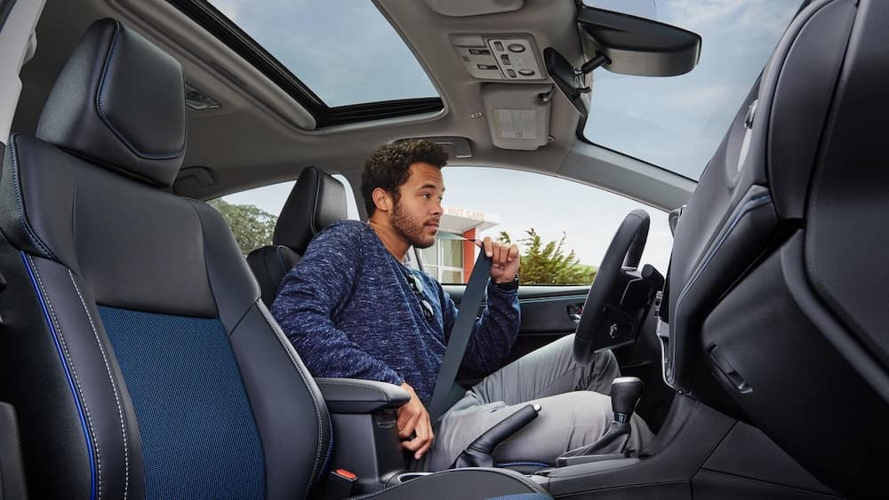 Man sitting in a 2019 Toyota Corolla
