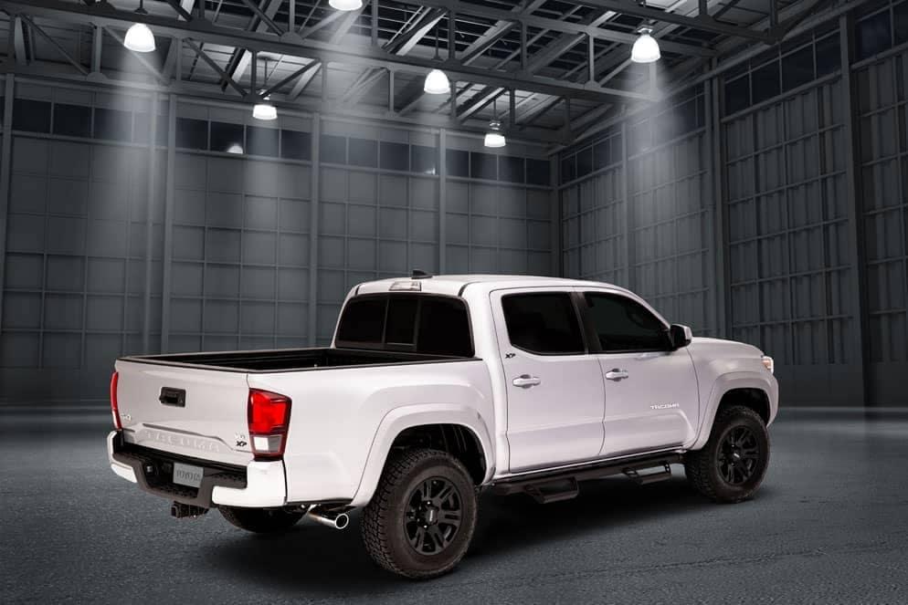 Toyota Tacoma XP Black Maverick rear view in warehouse
