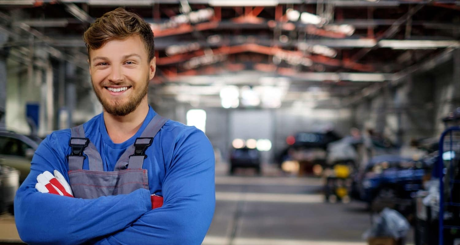 Cheerful serviceman in a car workshop_91820782 (1)