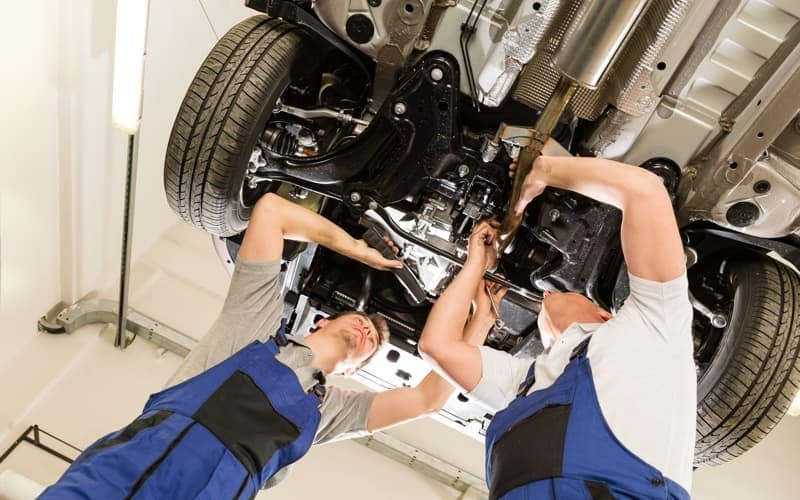 service techs working on car