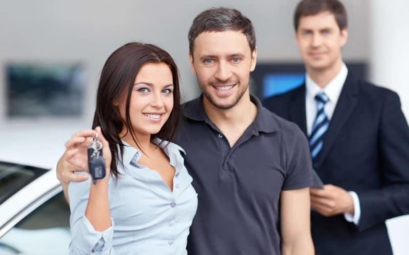 couple holding up car keys