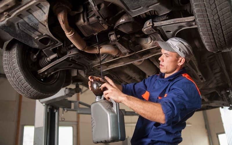 Mechanic draining oil