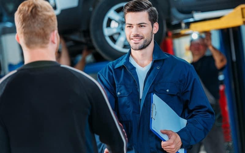Mechanic welcoming client