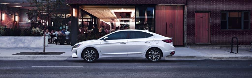 Washington Hyundai is a Hyundai Dealership in Washington near Canonsburg PA   White 2020 Elantra Street Parked in City