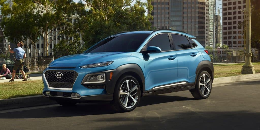Washington Hyundai is a Hyundai Dealership in Washington near Arden, PA   Blue 2020 Kona parked on city street