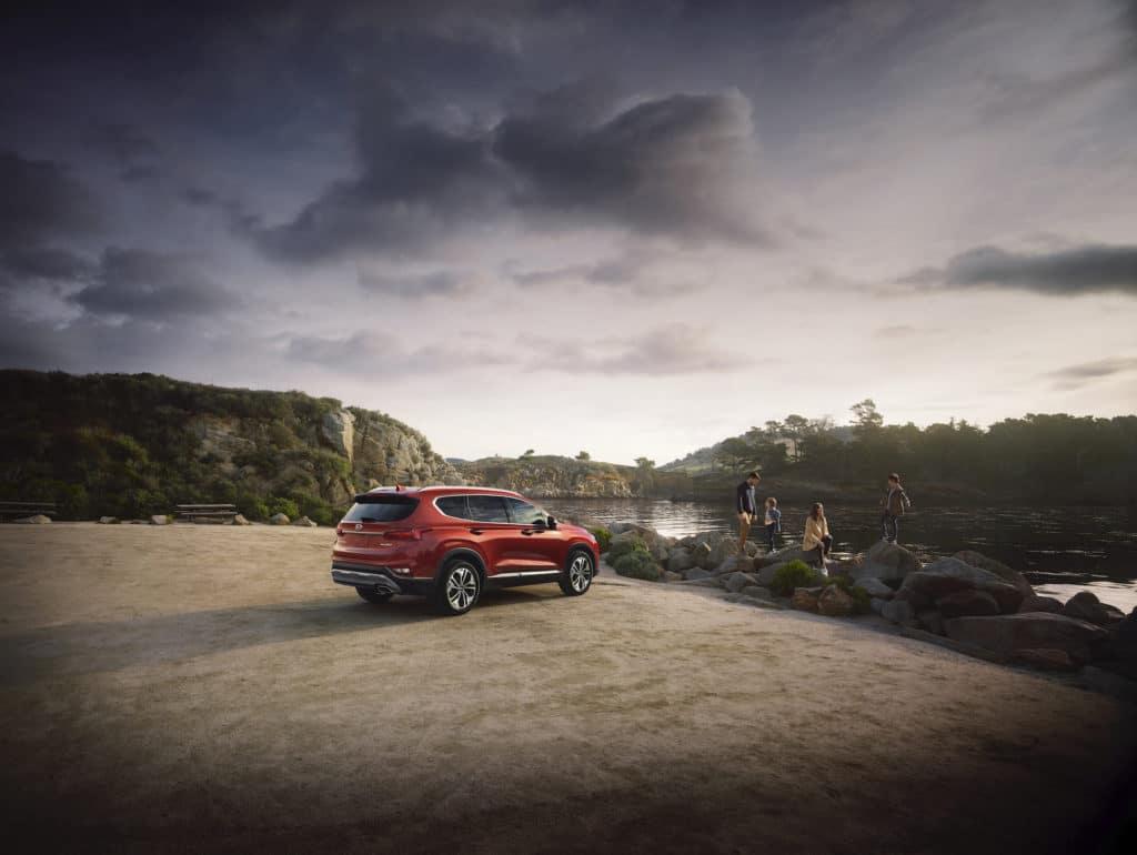 Washington Hyundai is a Hyundai Dealership in Washington near Bethel Park PA | Orange 2020 Hyundai Santa Fe parked by lake