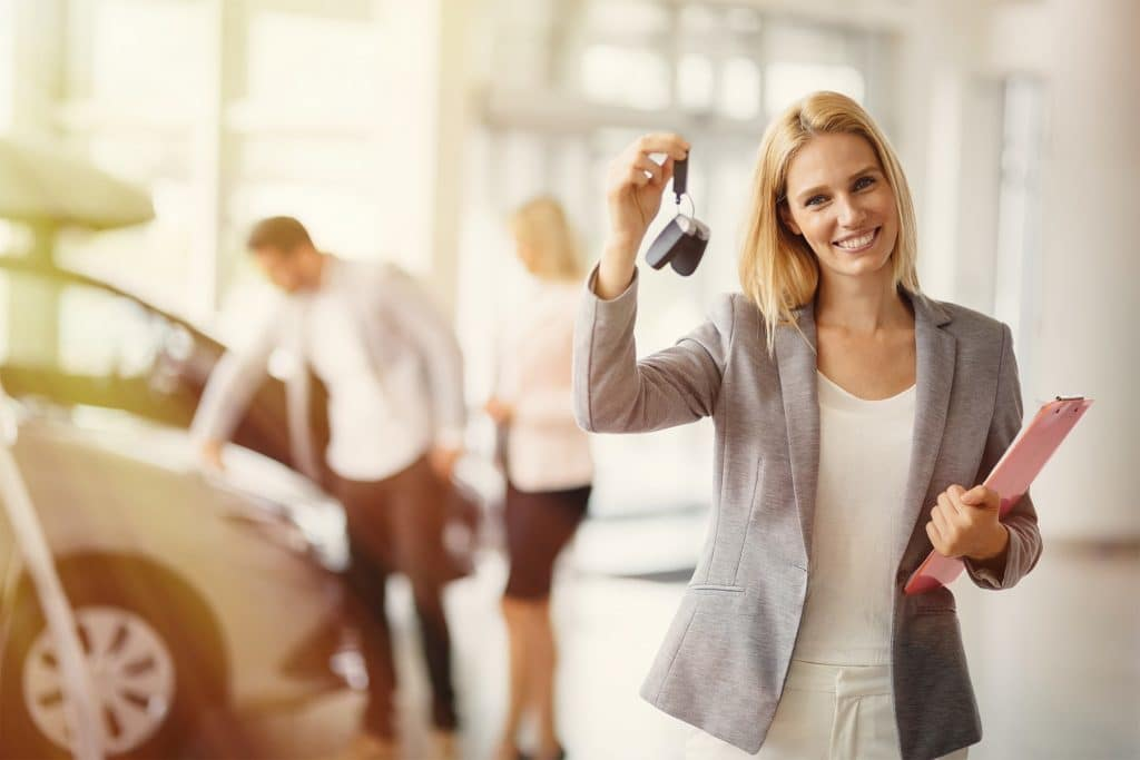 Washington Hyundai is a Hyundai Dealership in Washington near Bethel Park PA | Car saleswoman holding car keys in showroom