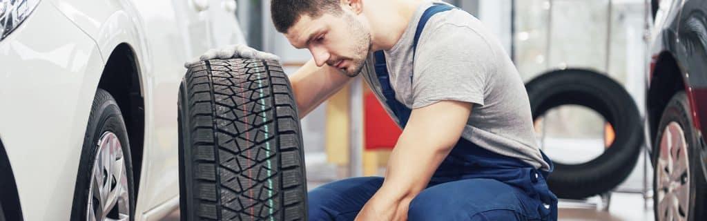 Washington Hyundai is a Hyundai Dealership in Washington near Canonsburg PA   Service Advisor Changing Tire on Vehicle